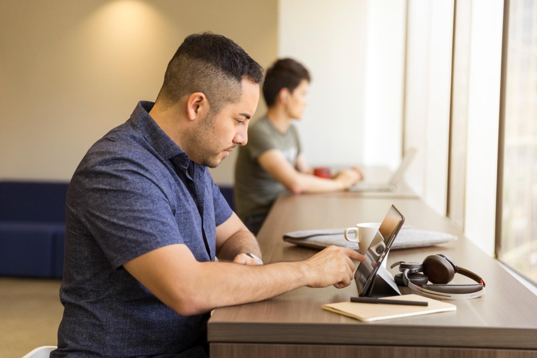 man on laptop comparing rv loans